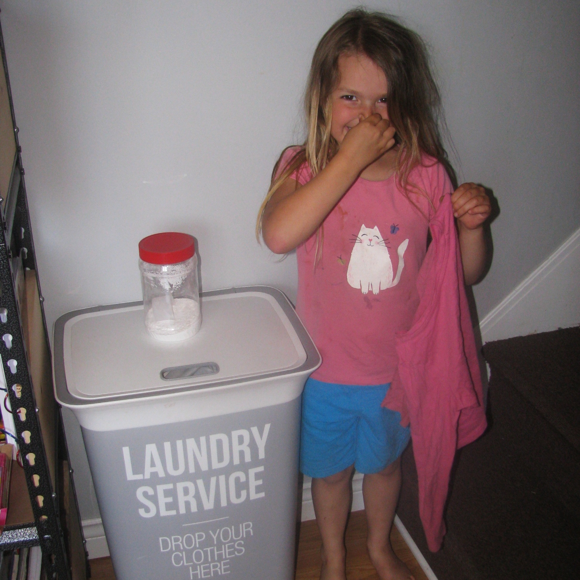 My cute daughter holding some 'very stinky' clothes!