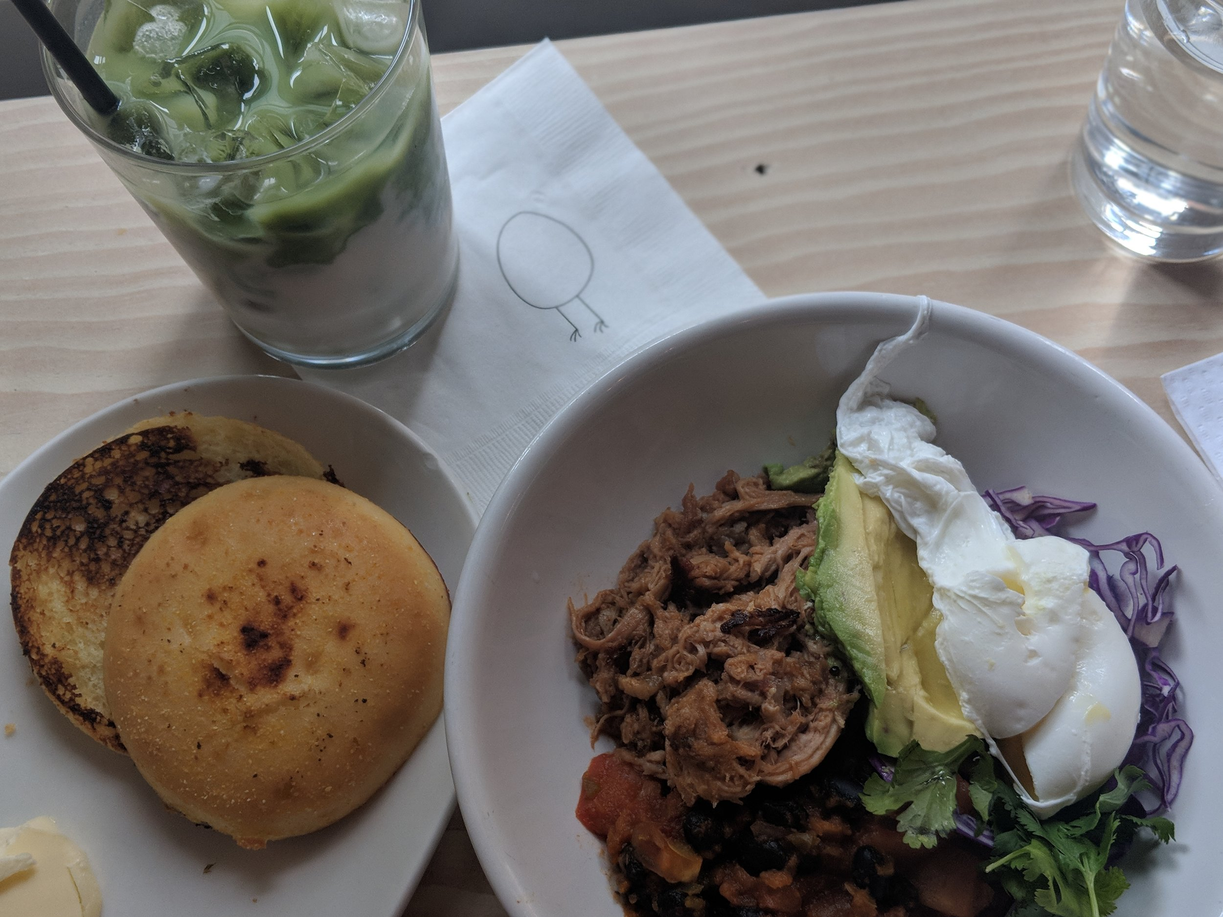 'El Camino' Poached egg, avocado, pulled pork carnitas, tomato, fried tortilla (subbed for muffin) at Egg Shop.
