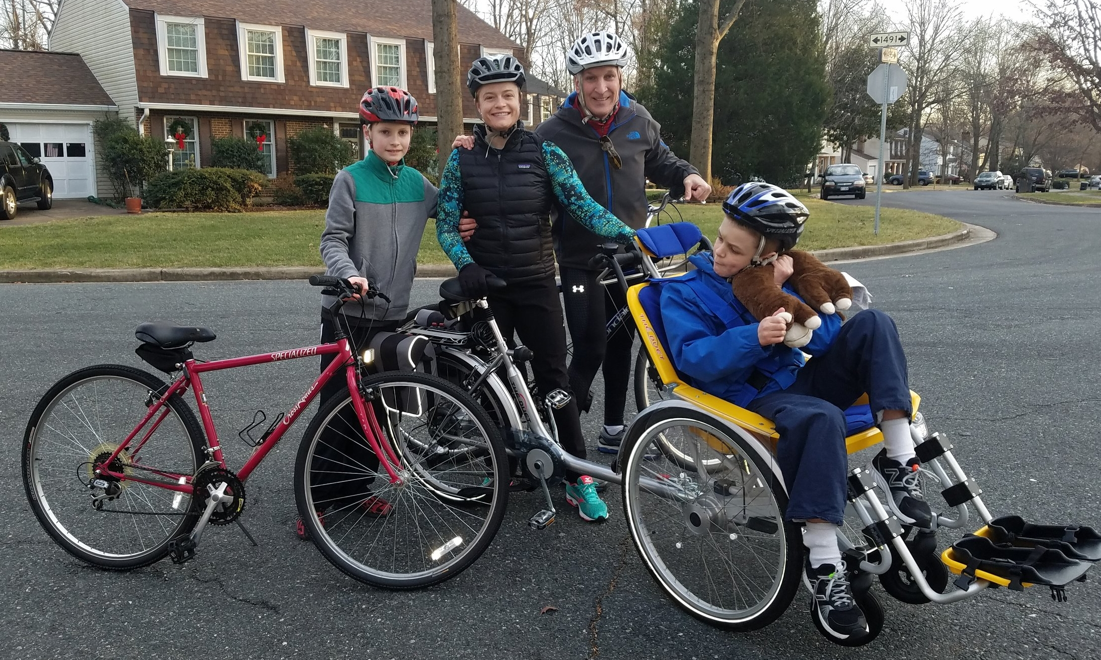 Recent photo of recipient Jonathan Tower enjoying his adaptive bicycle provided by the Eric Fund.