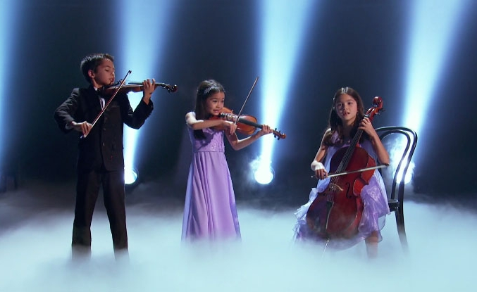 The Little Stars Trio performing onstage for NBC's  Little Big Shots  in early 2018.