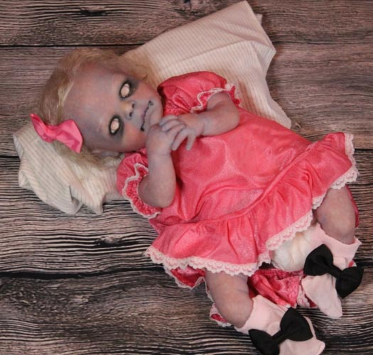 One of  Twisted Bean Stalk Nursery 's spine-tingling baby dolls.