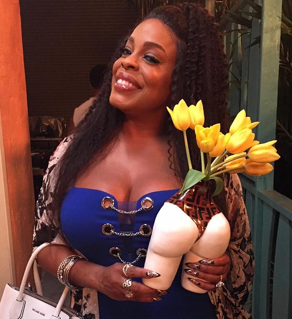 Claws  actress Niecy Nash is the proud owner of one of Barnes' Fendi-clad vases. (  Barnes  )