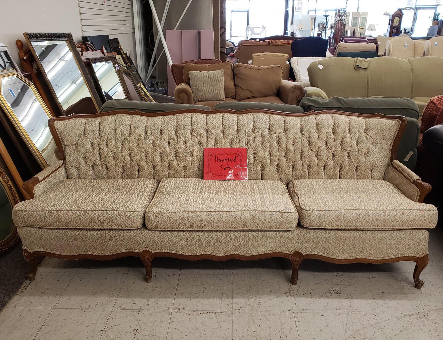 The infamous haunted couch in Waco, Texas. ( Consignment Furniture Showroom )
