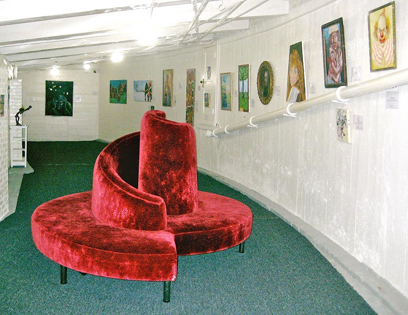 The Museum of Bad Art's interior when it was located in the basement of a Massachusetts movie theater. ( MOBA )