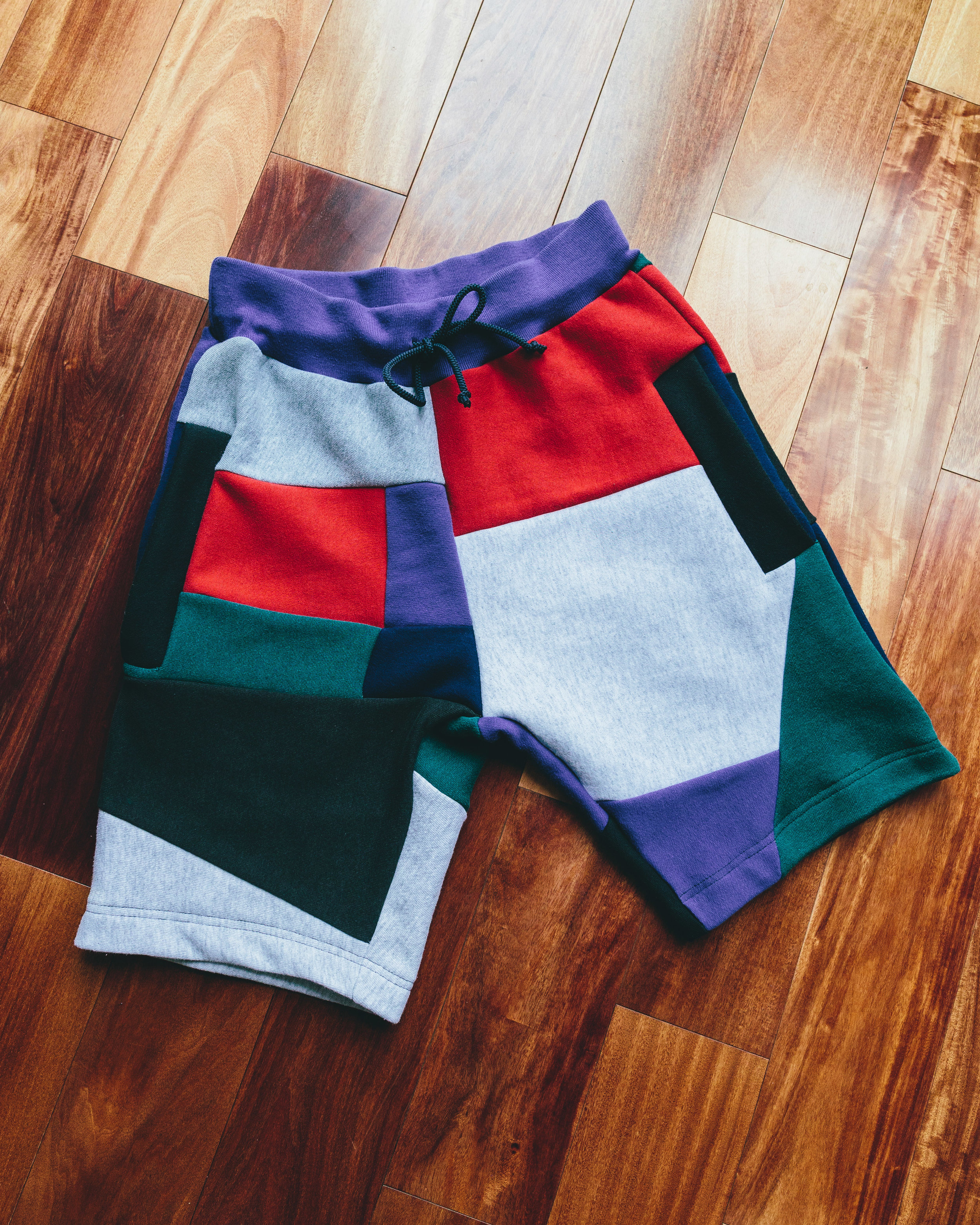 Mosaic patchwork shorts - Inspired by vintage nike and other athletic brands that used teal red and purple on many 1980's and 1990's clothing, hat, and shoe designs.