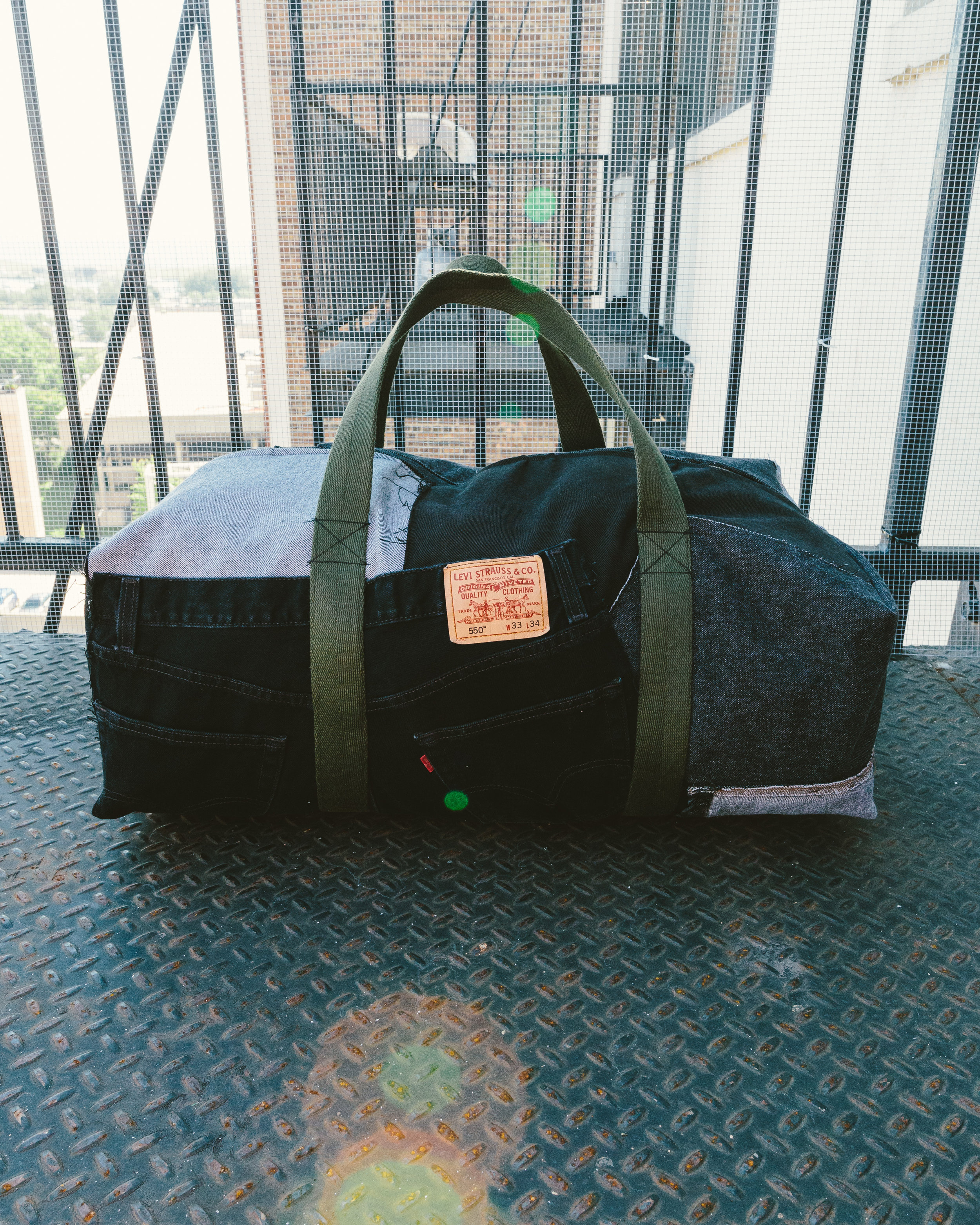 Large Levi's Duffel - Made from Denim and including the focal point of a pair of Levi's with the classic patch.