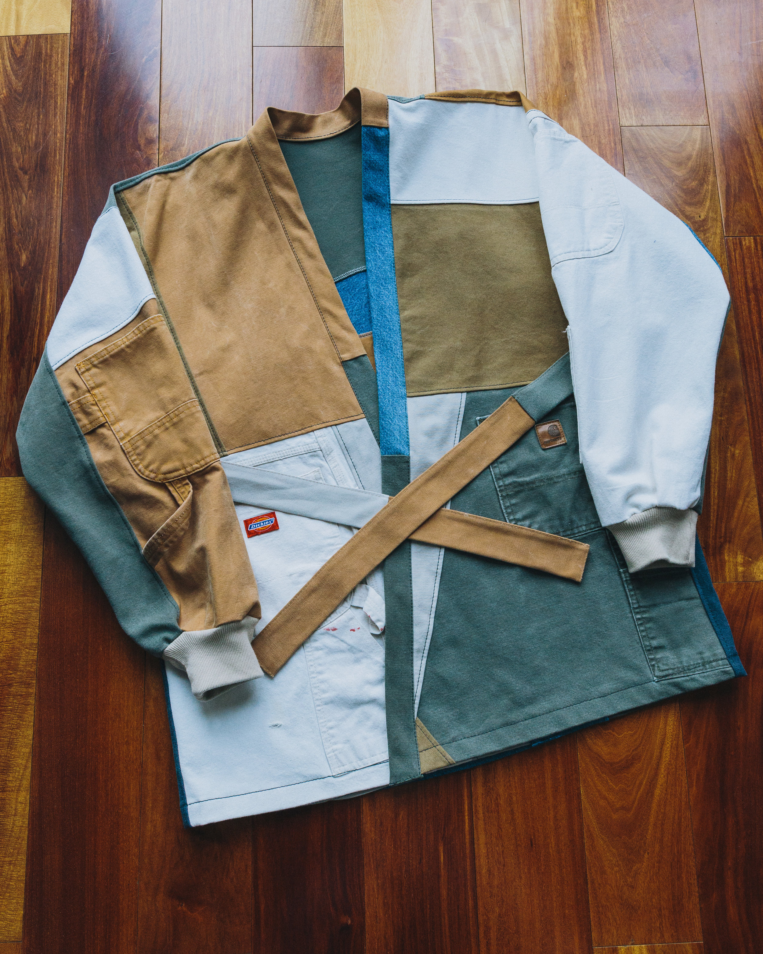 Patchwork Kimono - A combination of olive Carhartt pants, painter's dickie pants, normal blue denim, and other work pants along with a strap to tie it together.