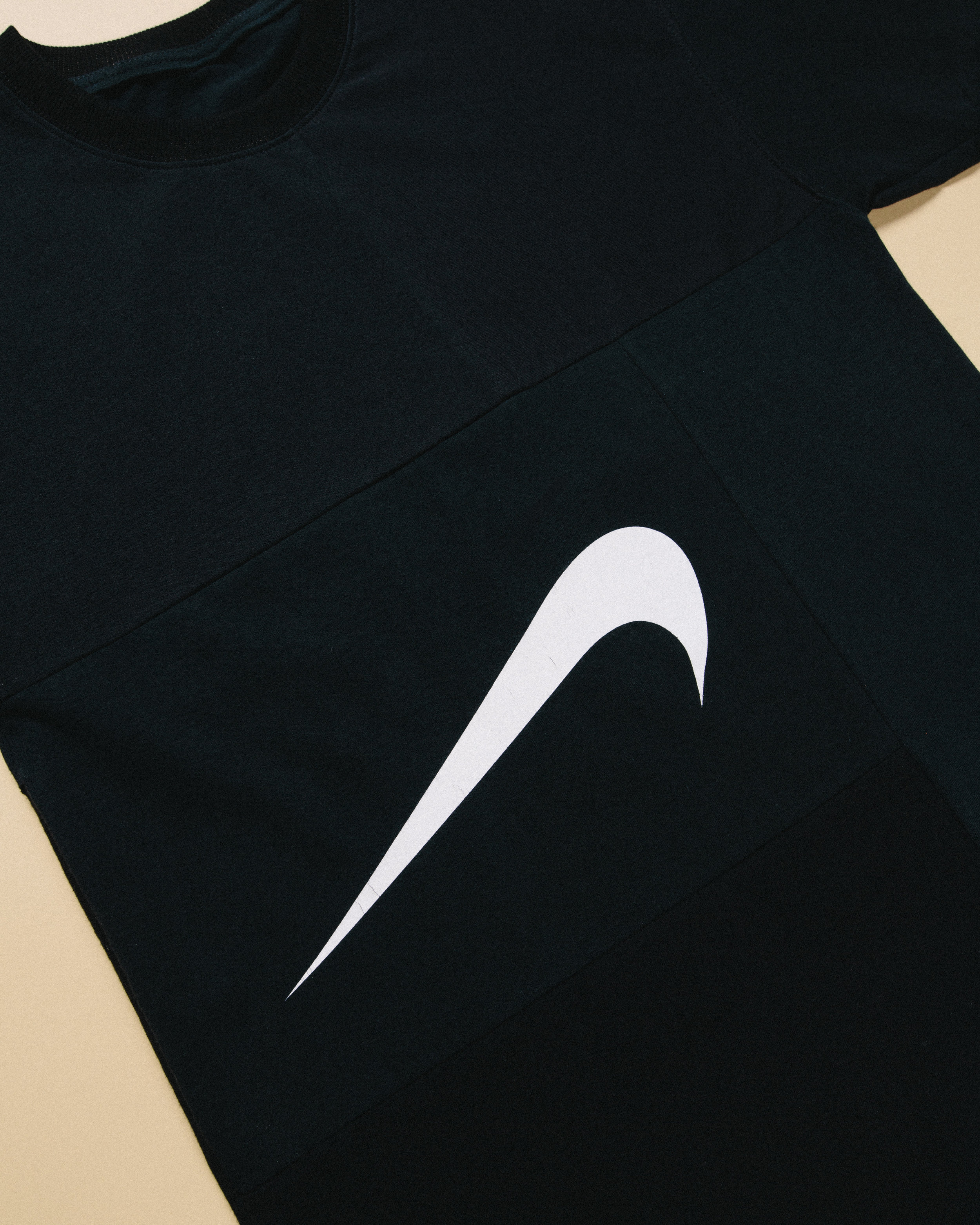 Upside Down Swoosh - Made using several tones of black t-shirts along with the main nike tee to create a new take on the classic swoosh