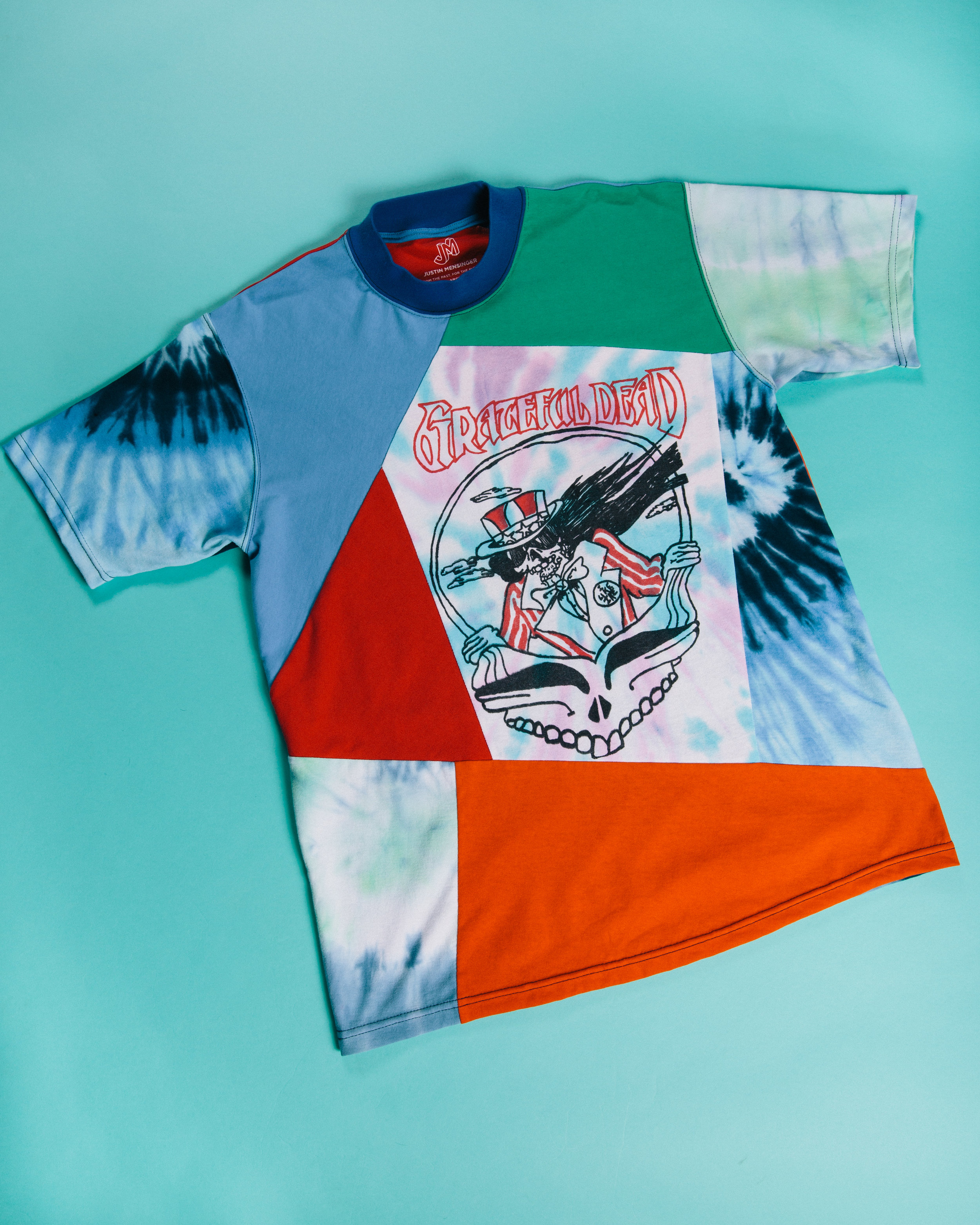 Grateful Dead Tee - A patchwork of multi tie dyes and vibrant tones.