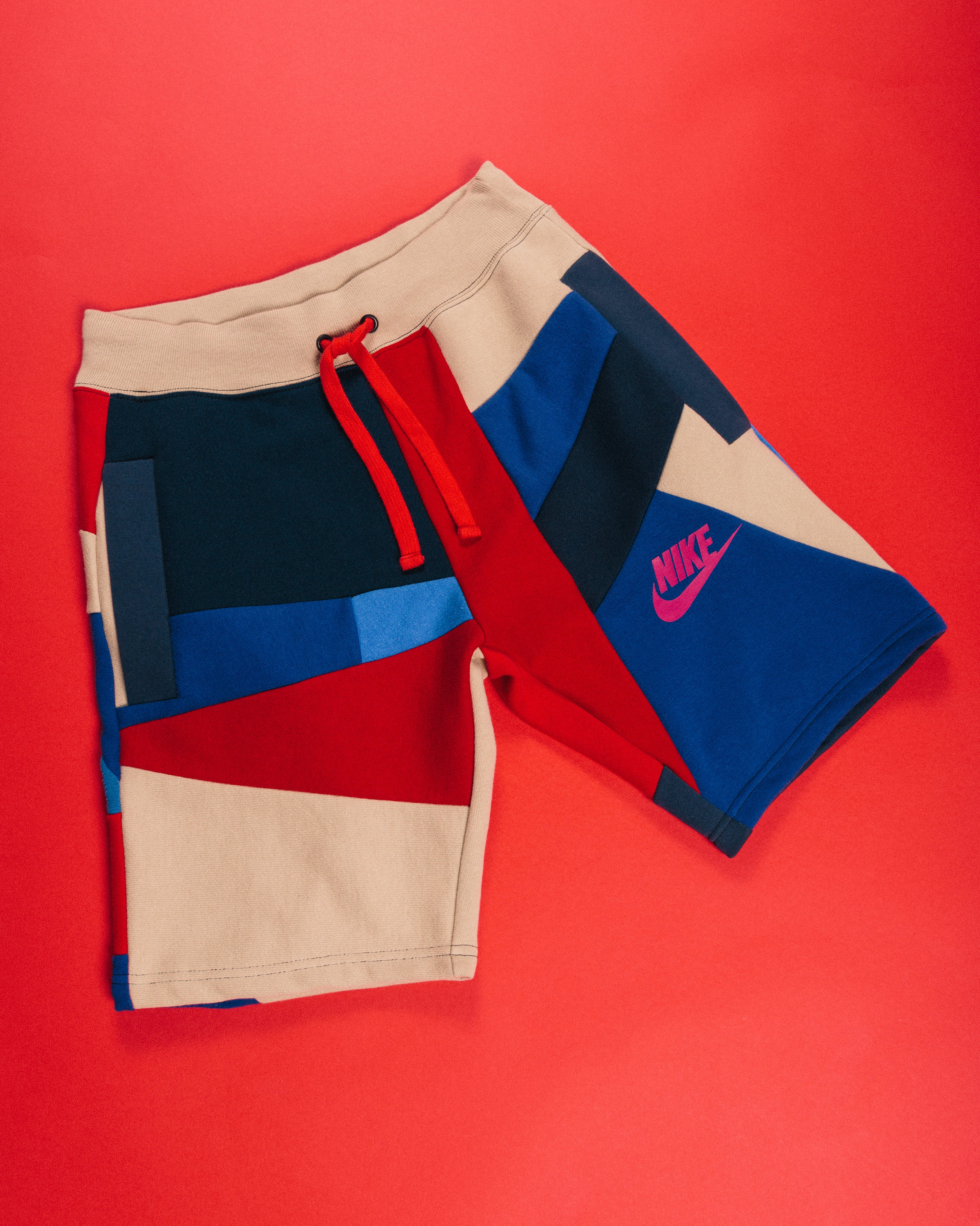 Nike Mosaic Shorts - 1 of 1 made reusing the chest logo of a nike sweatshirt as well as some champion reverse weave fleece and more.