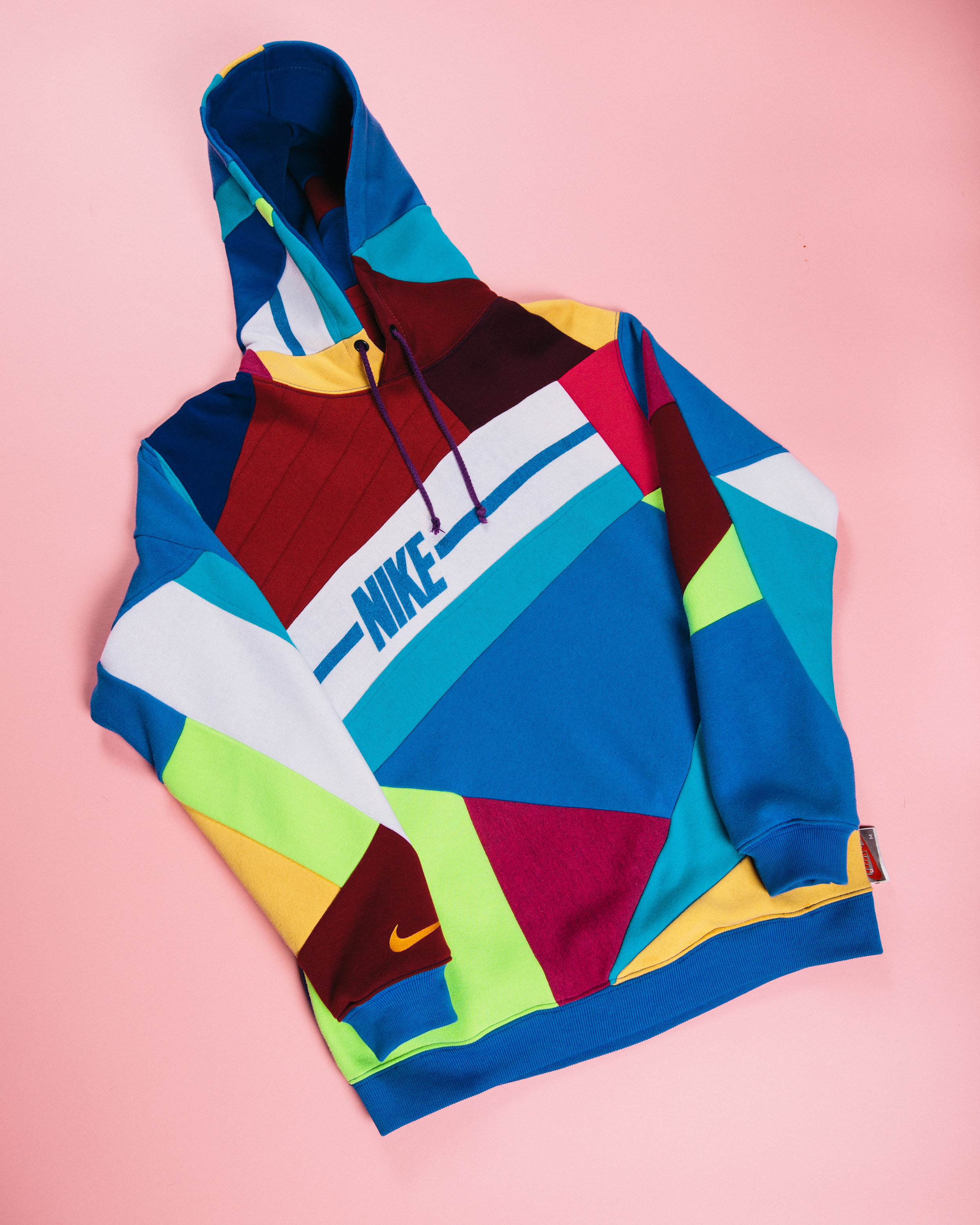 Multi-Layered Nike - Made reusing several Nike pieces as well as other texture and colored patterns of fleece to make a truly one of a kind piece.