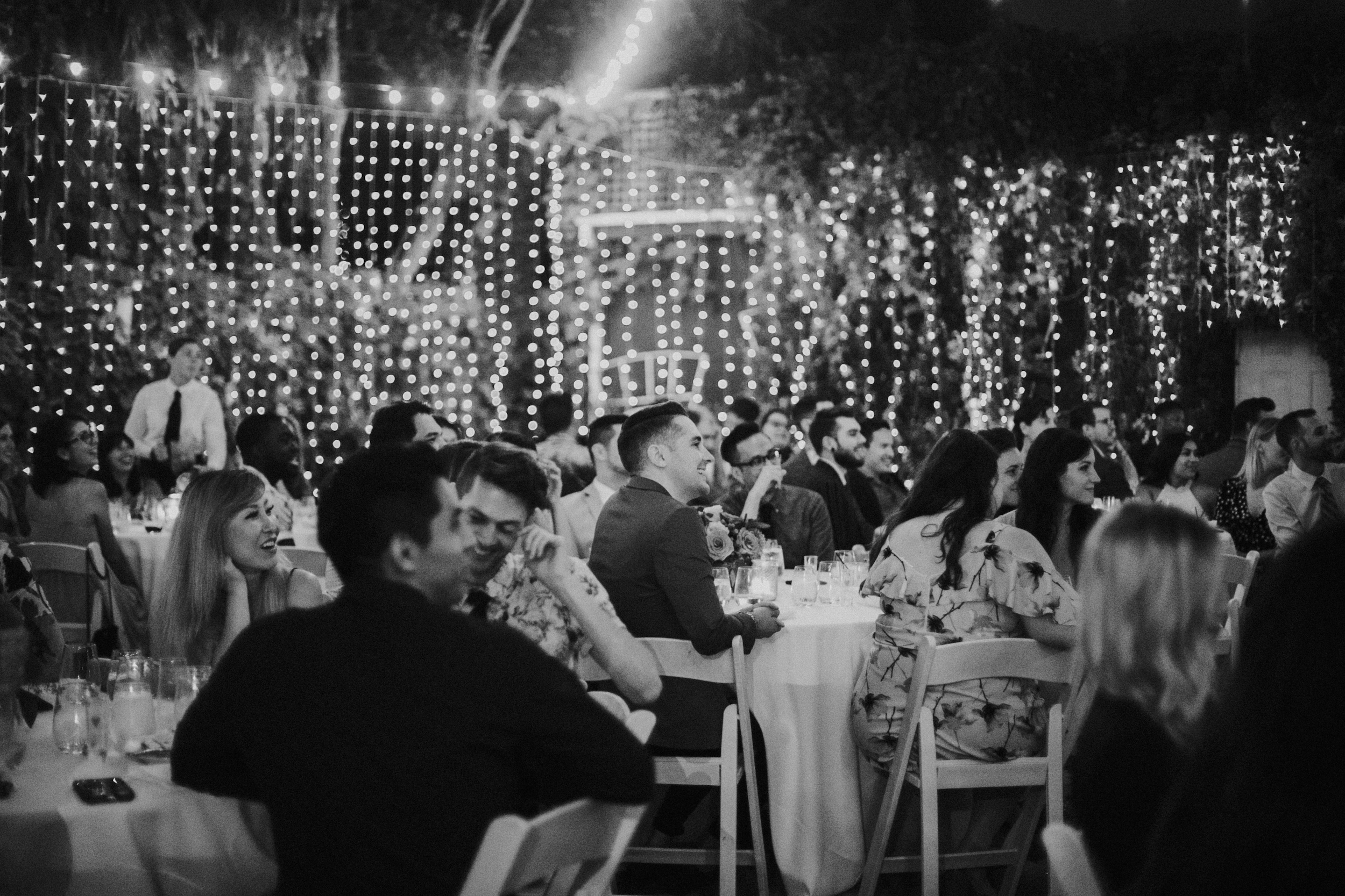 Photo showing our guests seated at the dinner tables in black and white. Beautiful!