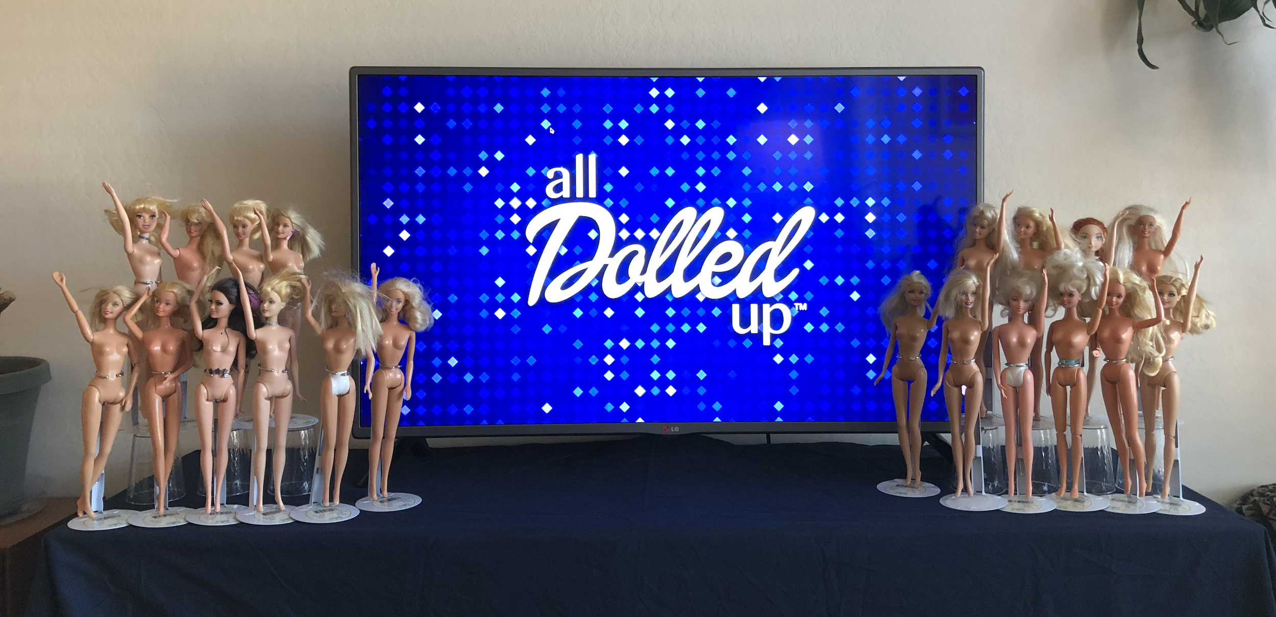 The models displayed on the left and right of the logo on the TV.