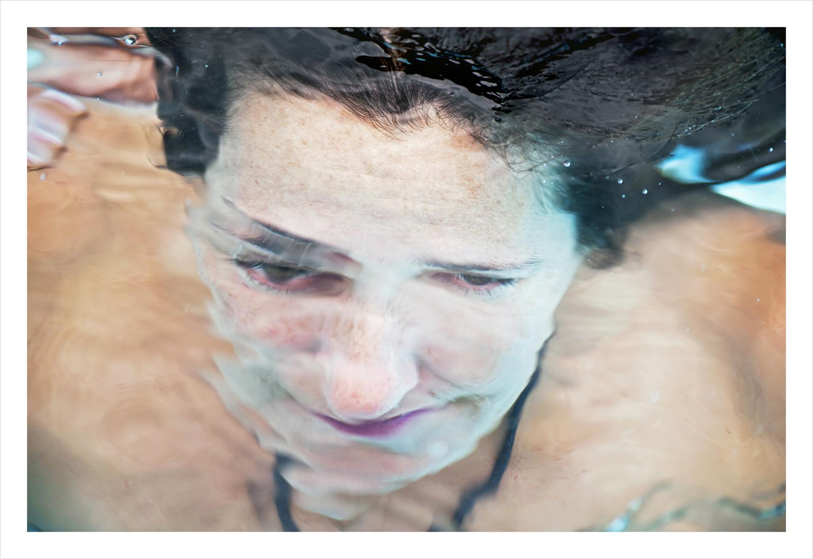 woman under water with one big eye