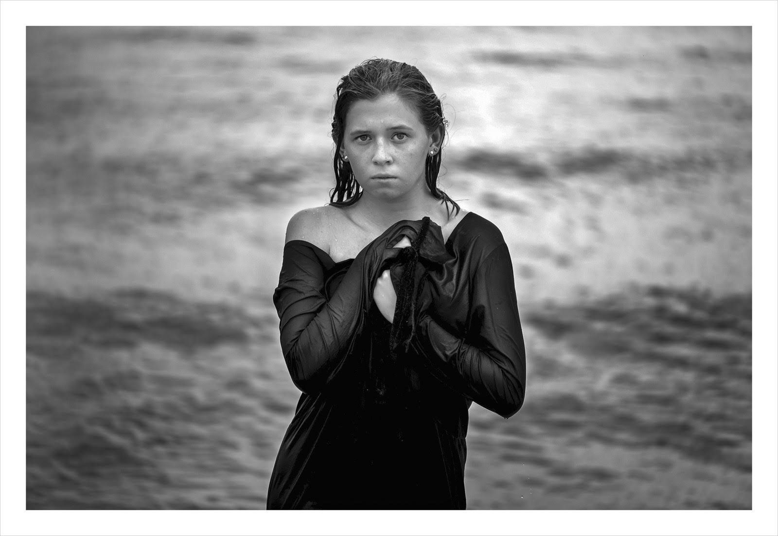 woman in front of water b and w #3