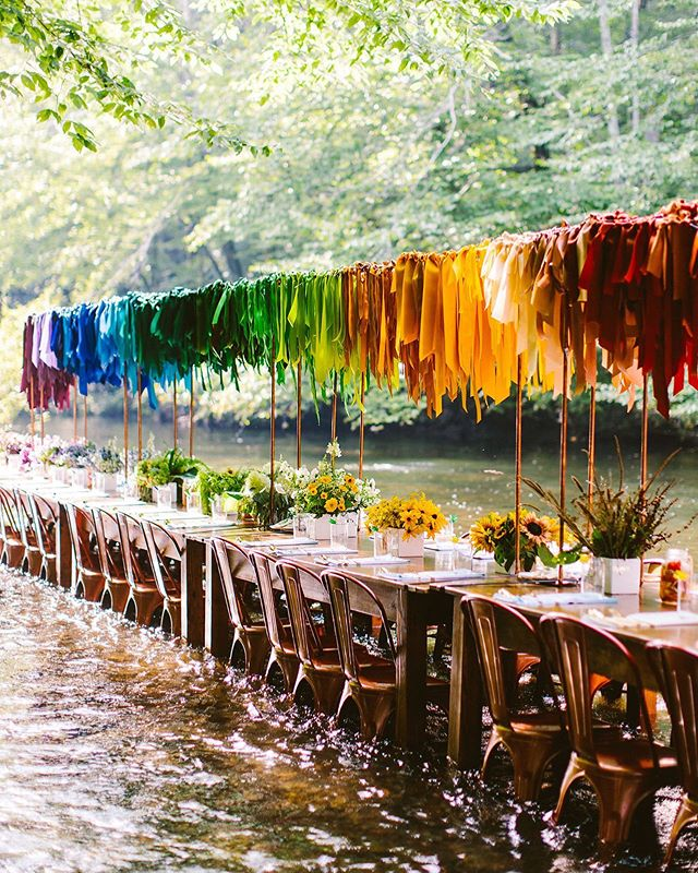 "This rainbow of ribbons created by @alliumfloraldesign for our ""put yourself in the way of beauty""-themed Bacon & Lox Society Full Circle Meal, inspired so many people. Long after the creek had been packed out and everything dismantled, this rainbow installation lived on in many iterations with people who had seen it and felt a connection. As we prepare for the 4th annual Full Circle Meal, our message for this year's gathering is inspired by the relationship between the act of creating and what happens when others interact with our art. What will your ripple be? #blscreekdinner 📷 @redfieldphoto  Bacon & Lox Society Full Circle #baconloxsociety #blscreekdinner 