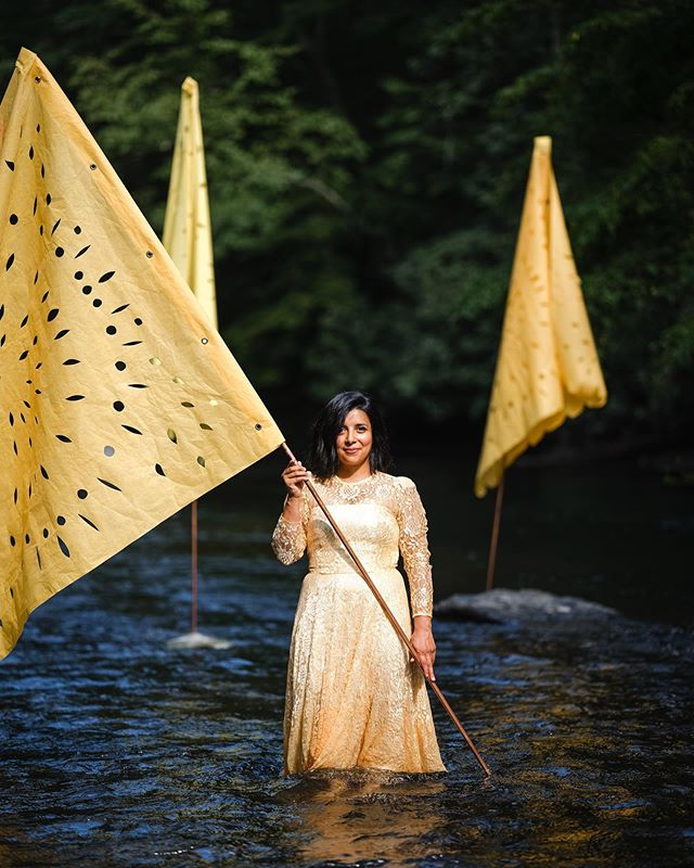Artist Karina Puente @karinapuentearts made four large scale papel picado sunflower yellow flags, representing each year we've gathered for our Full Circle Meal. They were installed in the water in pyramid bases up-creek at the head of the table, custom built by @abundat_inc 📷 @alisonconklin #blscreekdinner  Bacon & Lox Society Full Circle Meal @baconloxsociety #blscreekdinner Alisa Tongg, Celebrant, Founder + Producer, @alisatongg | Nicole Hutnyk, Visual Direction, Planning & Invitation Design, @rabbitrabbitcrew | Sarah Petryk, Floral Installations & Visual Direction, @alliumfloraldesign | Alison Conklin, Event Photographer, @alisonconklin | Christian Lopez, Film, @dearlybeloved.weddings | Karina Puente, Papel Picado Installation, @karinapuentearts | Abundat Inc, Custom Builder, @abundat_inc | Hand Sawn LLC, Communal Tables, @handsawn| Chippy White Table, Creek Seatings and Lounges, @chippywhitetable | Rob Yaskovic, Water Portraits, @robyaskovic | Chefs: Andre de Waal @dewaal_a , Mike Carrino @mikecarrino and Brandon Grimila @brandongrimila | Promise Ridge, Venue, @promiseridge | Ken Jones Jr. X Two Paper Dolls, Menu Napkins Collaboration @thisbeautifullifellc @tpddesignhouse | Jason Lonigro, Atomic Cocktail Experiences, @cocktailatomic | Tia Jones, Glow & Glisten Station, @merakibeautyllc | Chef Erika Urso, Ice Pops at Promise Ridge, @lovebitesbyerika | Honeywatts, Live Music, @_honeywatts_ | Ken Jones Jr., Activation Station, @thisbeautifullifellc | Shawnee Craft Brewery, @shawneecraftbrewingco | Local Flower Growers @periwinkleflowerfarm X @florestemporis |
