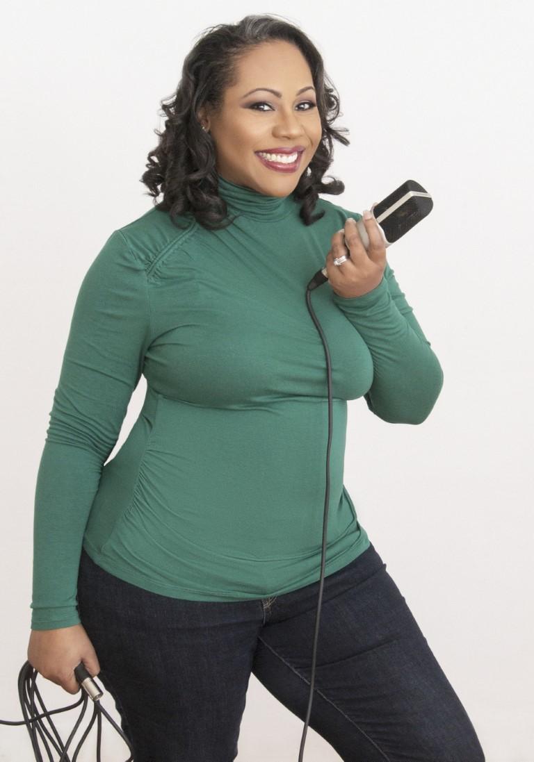 Daree Allen, black female voice over artist, holding the mic