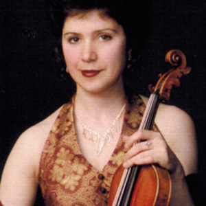 Araksia Nazlikian   Violin  Araksia Nazlikian began her violin studies at the age of 7 in Yerevan Armenia and received her BM from the Romanos Melikian Music College. She is an extremely active musician in various LA surrounding orchestras and has been teaching for over 20 years.