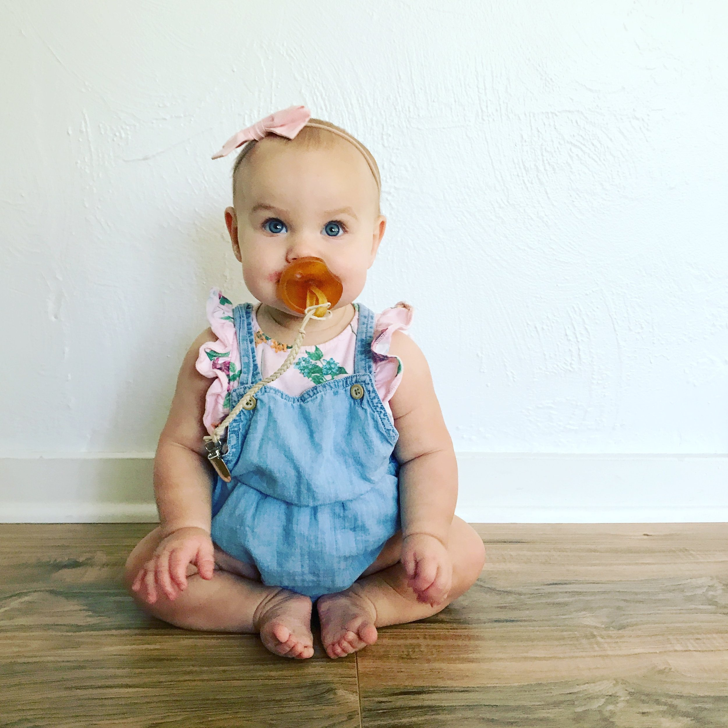 Overalls from gap and bubble romper underneath from Old Navy; bow from Happily Hadley Handmade