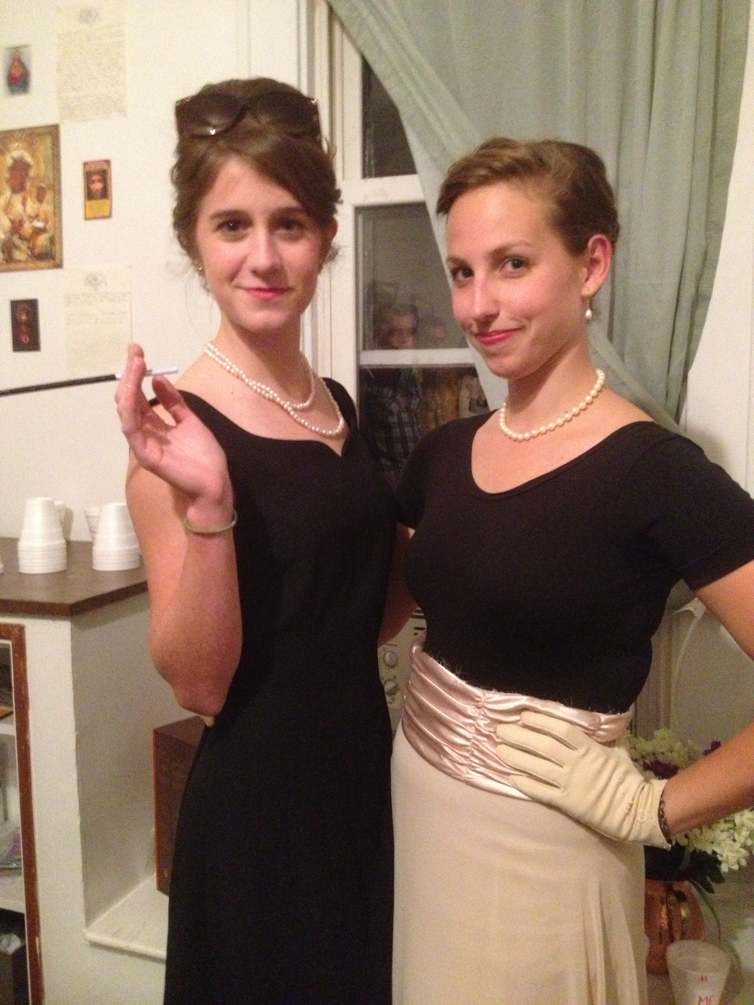 This is my friend Sarah and me.  Almost every part of our entire Audrey Hepburn and Grace Kelly outfits were from thrift stores.  I'm wearing Sarah's black leotard, but my skirt is the bottom half of a dress that I cut to look like a famous Grace Kelly picture.  The creepy men in the window are not from a thrift store.