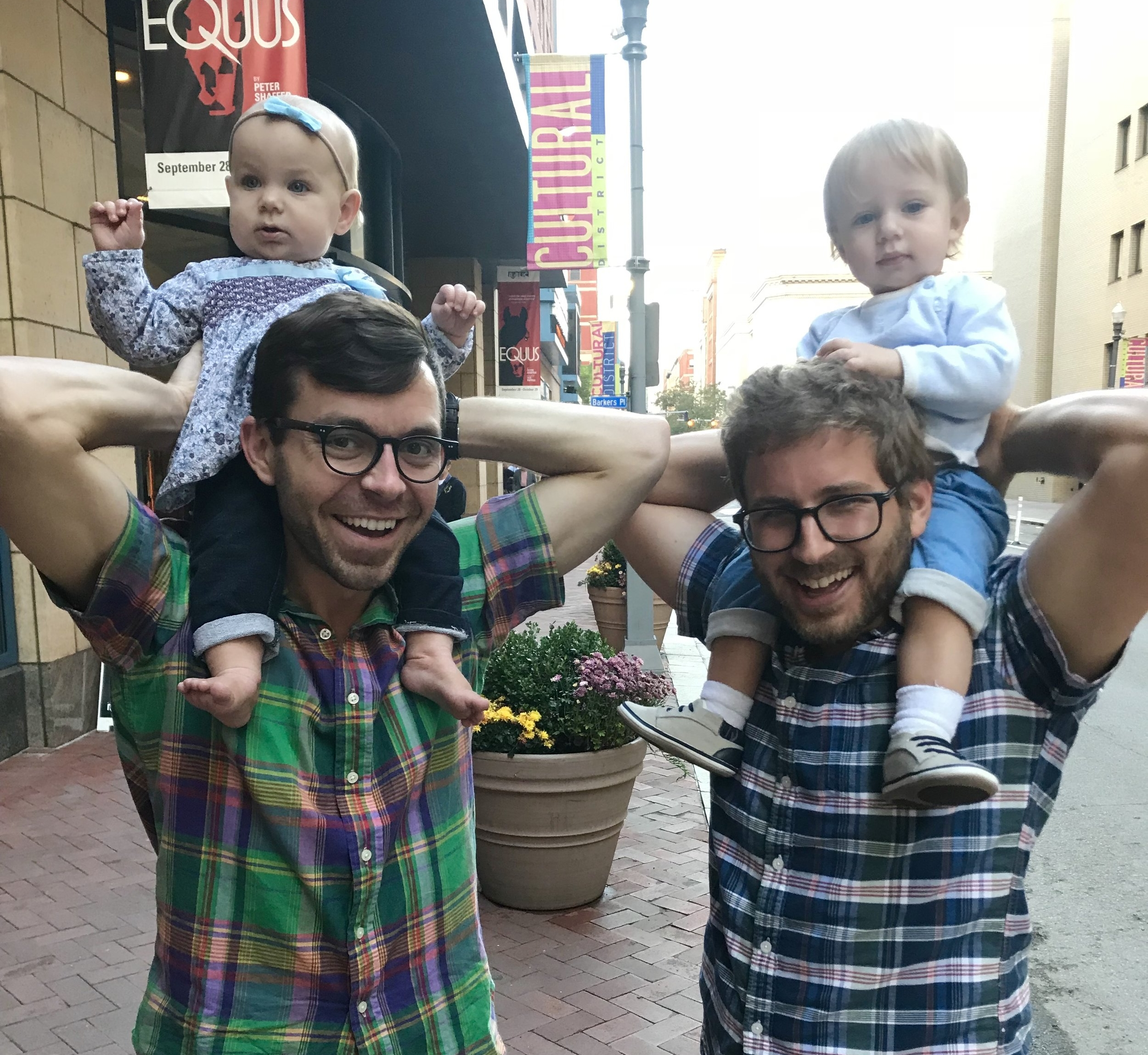 Boys holding the babes in the Cultural District of Pittsburgh