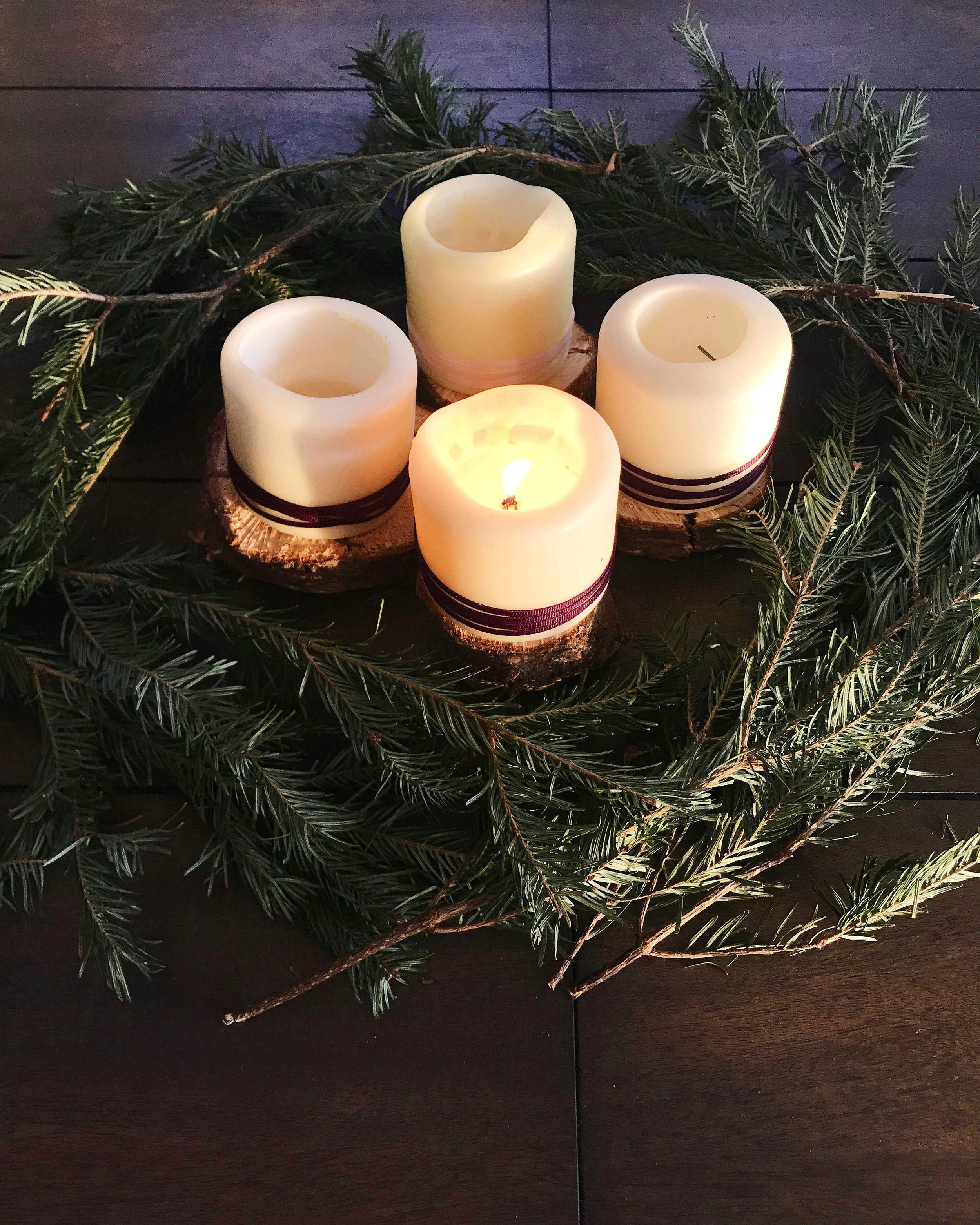 Here's our Advent wreath. When I went shopping for candles, I couldn't find pink and purple, so I improvised.