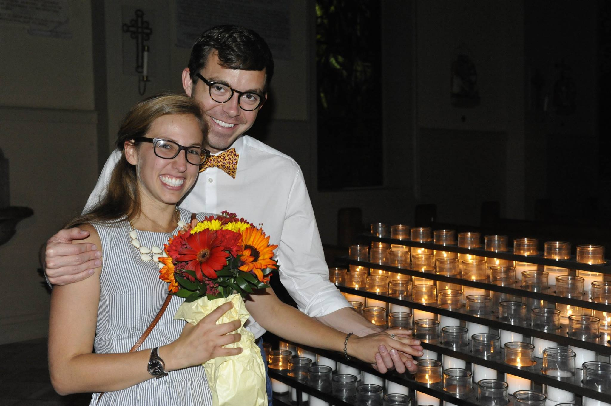 Here we are after we got engaged. I'm wearing the seersucker dress I wore on our first date and barely any makeup (because I am stubborn). Jonathan wanted us to pose by the candles so we could capture how shiny the ring was. That clearly worked great for this picture...?