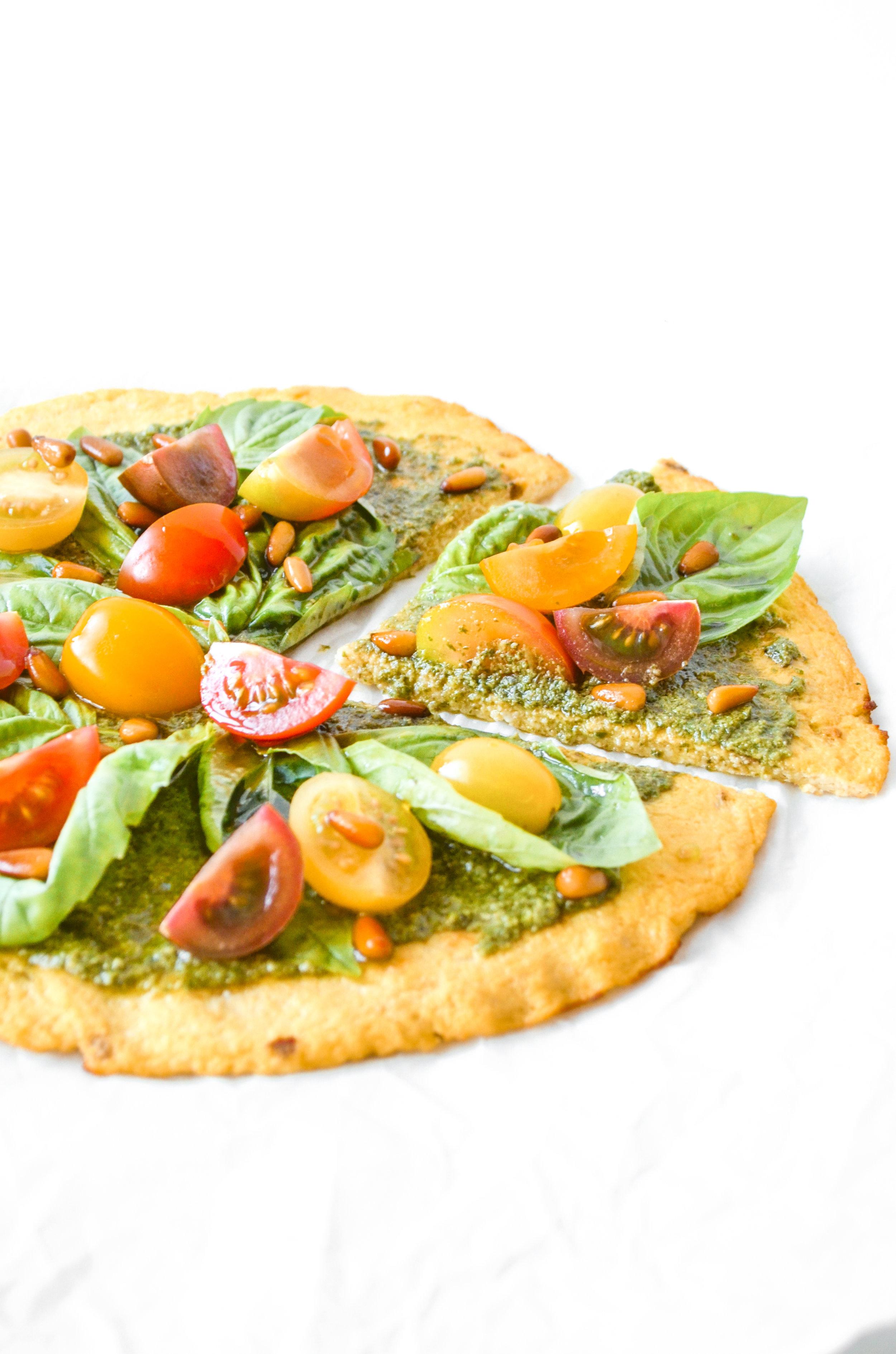 paleo pesto pizza with cauliflower crust // #ShiraRD #paleo #refinedsugarfree #SnacksbyShira