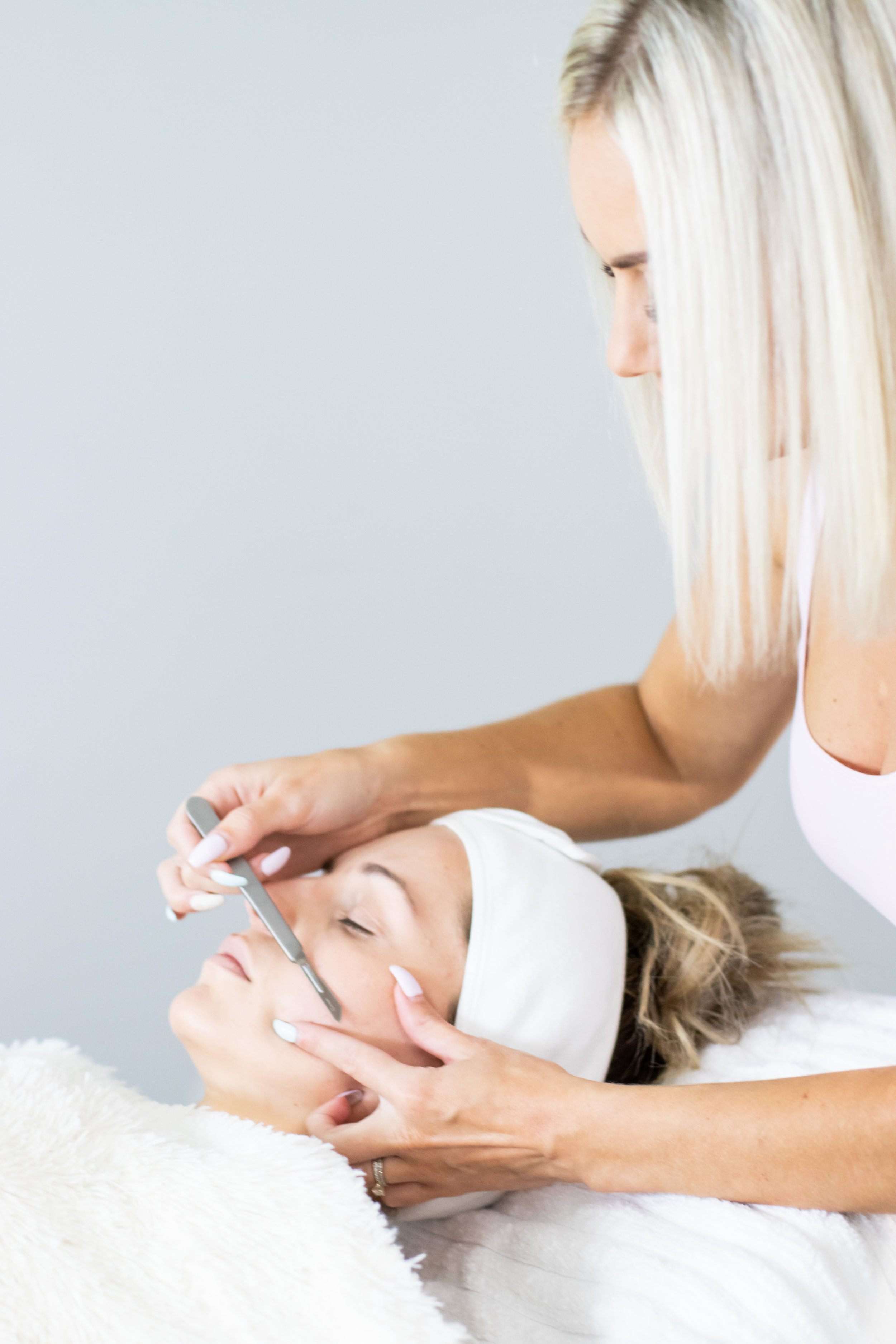 """- Dermaplaning is a cutting-edge exfoliation technique that utilizes precise, practiced strokes of a medical instrument to gently lift dull skin cells and fine,vellus hair, commonly known as """"peach fuzz."""" Causing no superficial irritation, dermaplaning is an effective exfoliation alternative to microdermabrasion or chemical peels for sensitive skin types."""