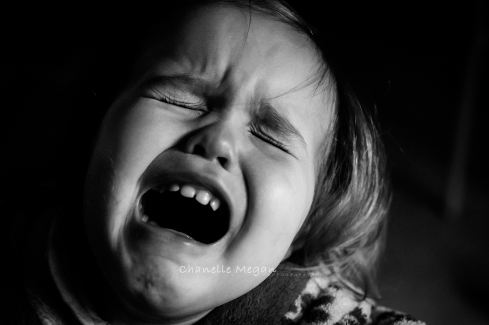Black and white emotive image of the struggle of the toddlers life.