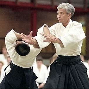 Moriteru Ueshiba (right), current Doshu of Aikido.