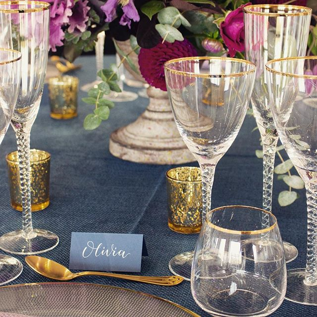 CLASSIC PLACE CARD // A simple tent card that blends in with this beautiful table scape by @oxo_2  Love white calligraphy on bold colours. Stunning flowers by @bloomologieflowers and little touches of gold . . #moderncalligraphy #whitecalligraphy #placecards #weddingplacecards #tentcards #blueandgold #navybluewedding #blueandgoldwedding #gfsmithpapers #gfsmith #drmartinsbleedproofwhite #luxurystationery #weddingshowcase #oxotower #oxo2 #tableplan #tableplans #namesettings