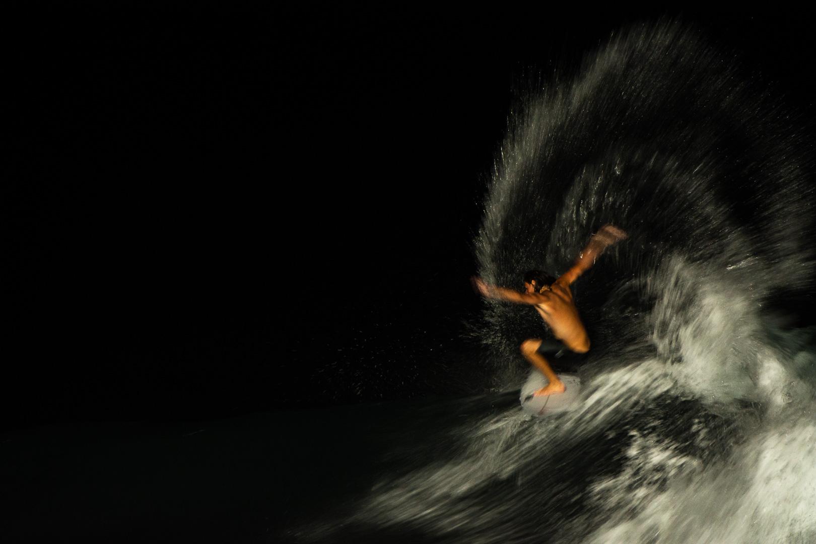 Kipp Caddy night surfing at Keramas.