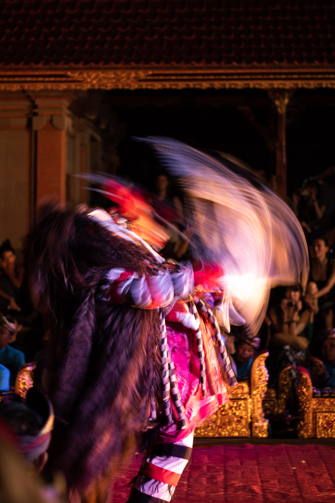 Using a slow shutter speed to capture the movement of the Balinese dancers.