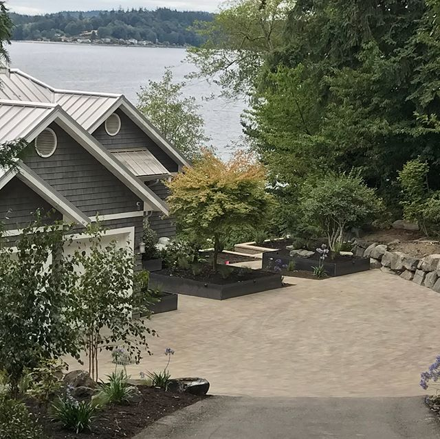 Finishing up this lovely high bank water front job on Henderson bay.  #paverdriveway #steelplanters