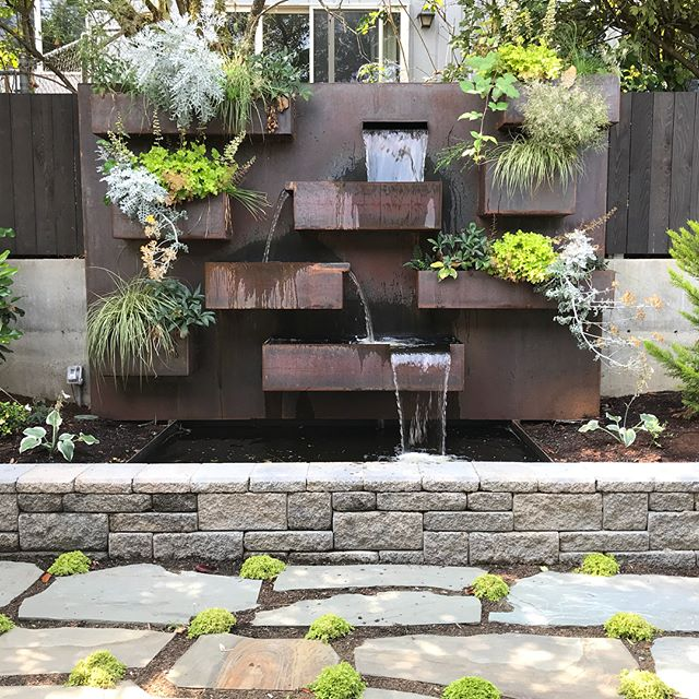 North Tacoma project from last winter. #steelwaterfeature #standupflagstone #benchswing