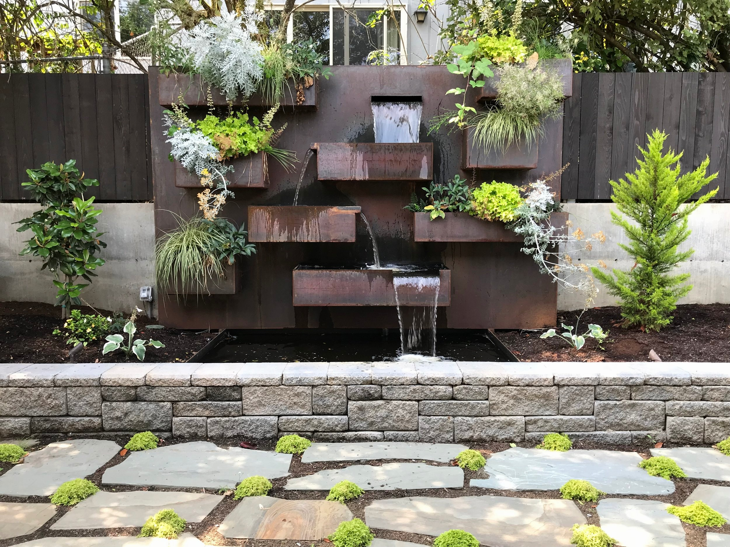 CRAFTSMAN:  N. Tacoma Update, steel water feature with sitting wall.