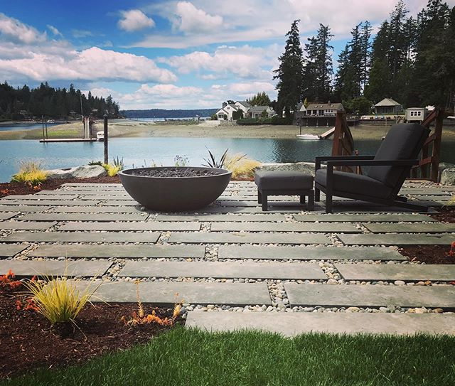 """Spring 2019 install. Loving these 12""""x48"""" Olympic pavers @castohn cant wait to see the plant growth next year! #nwcontemporary  #reikowdesign #waterfront #firepitpatio #somanyplants #gigharbor"""