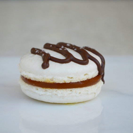SEA SALT CARAMEL: a salted caramel macaron with a home-made glossy caramel filling and topped with a dark chocolate drizzle and sea salt. This macaron is gluten free.