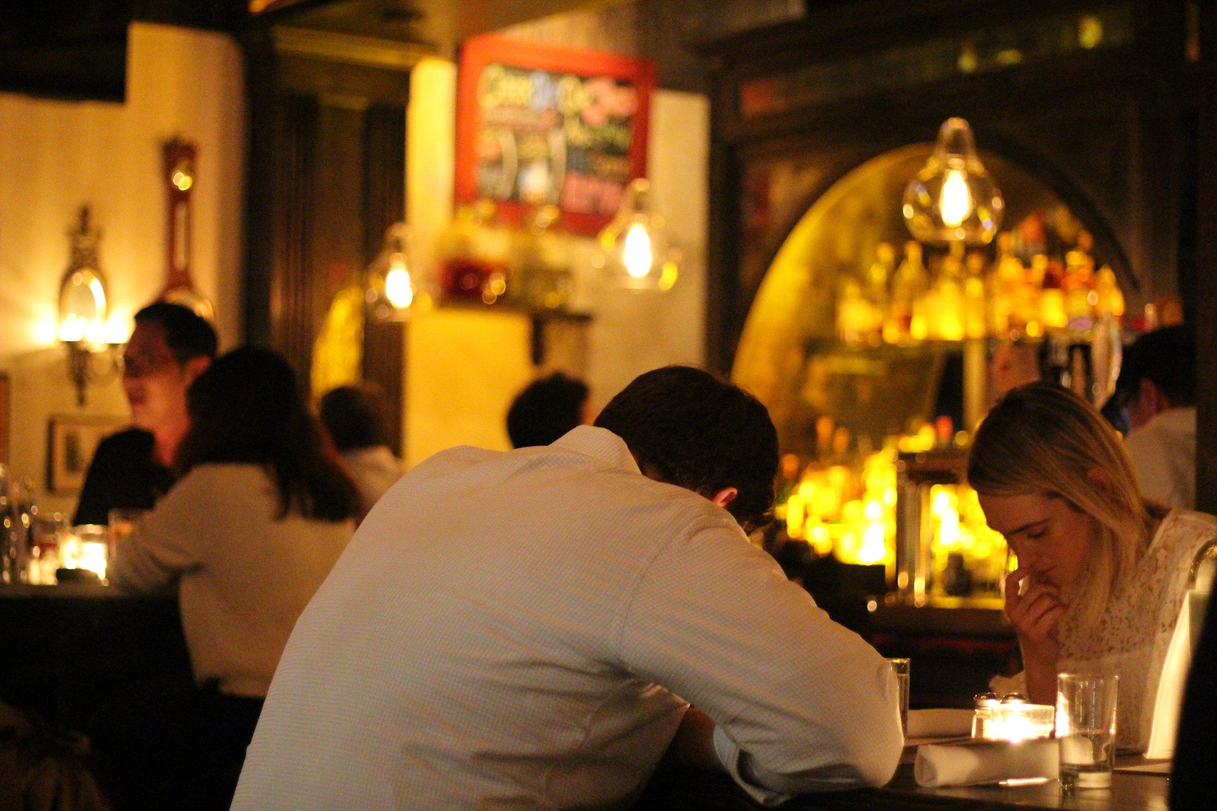 Studying the menu at White Oak Tavern