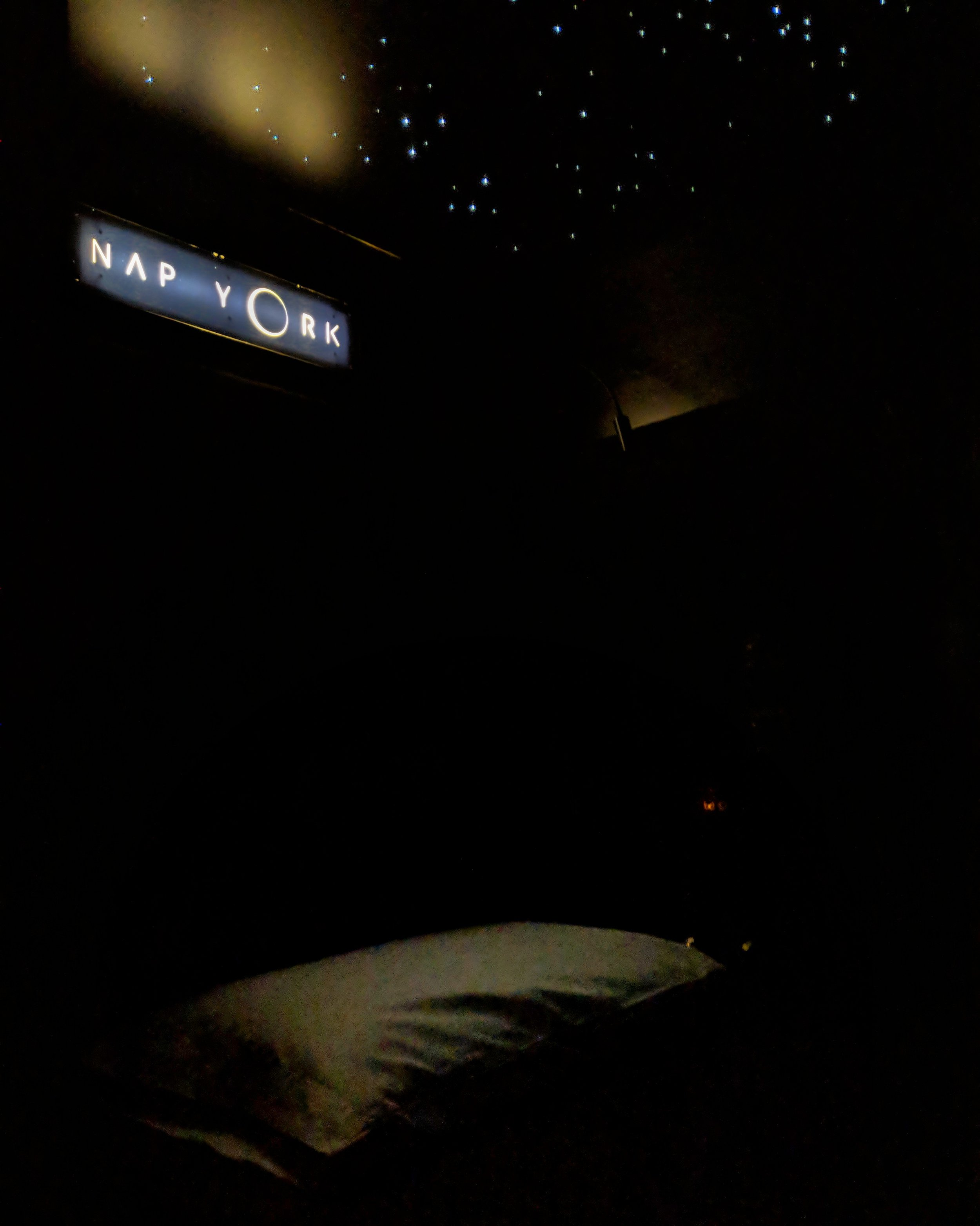 My pod with the lights out, minus the stars above the bed.