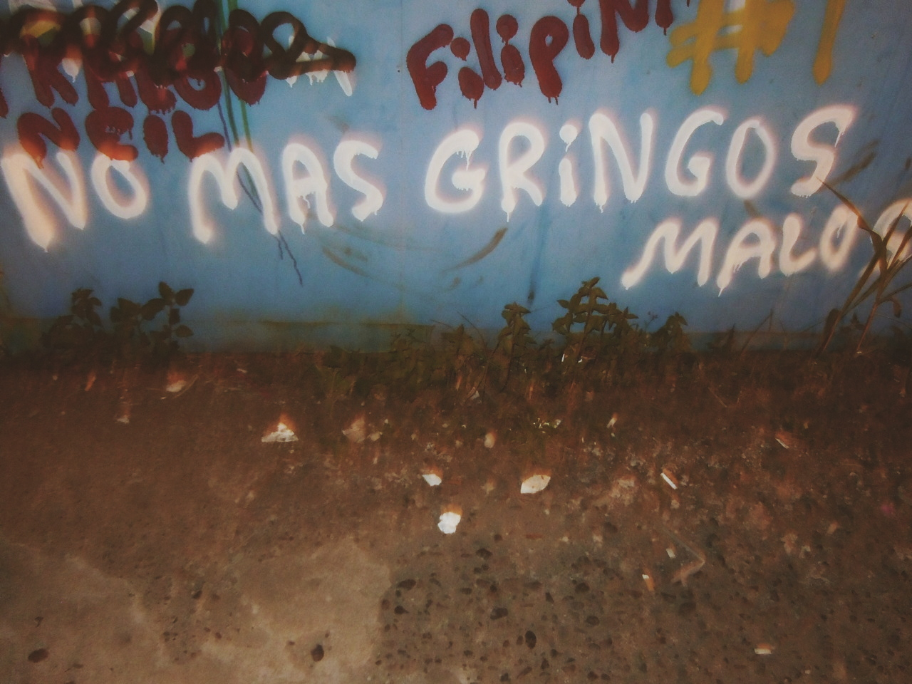 """Jaco, Costa Rica  graffiti roughly translating to """"no more bad gringos"""" Gringo is defined : a person, especially an American, who is not Hispanic or Latino.  Don't be a bad gringo friend"""
