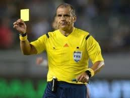 UEFA officials show the colour of their spines