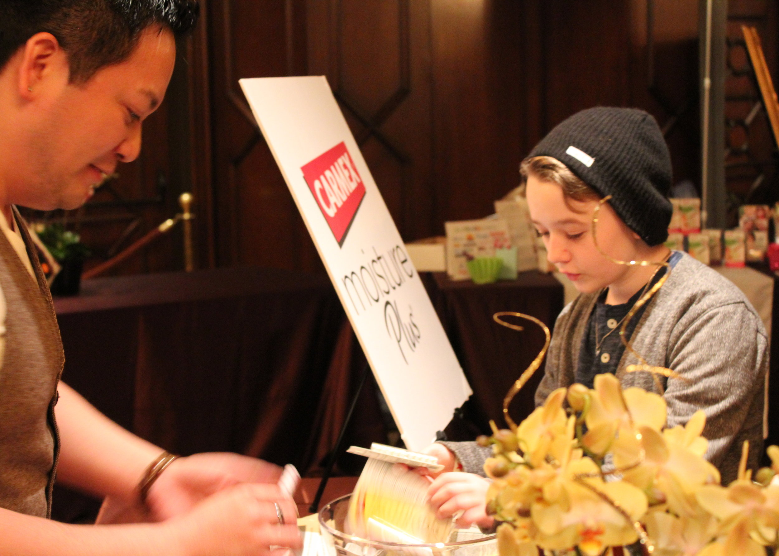 """Benjamin Stockham (""""About A Boy"""") checks out the Carmex booth."""