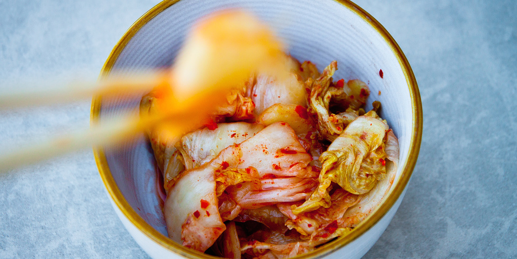 """KIMCHI - Kimchi is a traditional fermented Korean dish, which usually includes pickled cabbage, radish, scallion, and cucumber. Fermenting involves converting the carbohydrates and sugars in the food into an acid or alcohol; the result produces probiotics (good bacteria) that promote better absorption of nutrients from food. """"A couple reasons I love fermented foods are that they introduce lots of good bacteria to your gut and increase nutritional value of the food,"""" Glassman says.Enjoy it: Nutrition Stripped's McKel Hill shows us how to make kimchi made with kale, napa cabbage, napa root, apples, and carrots. Don't have time to make your own? Our nutrition editor offers three different waysto enjoy this delicious fermented food.Photo credit: daniel_gies via Flickr"""