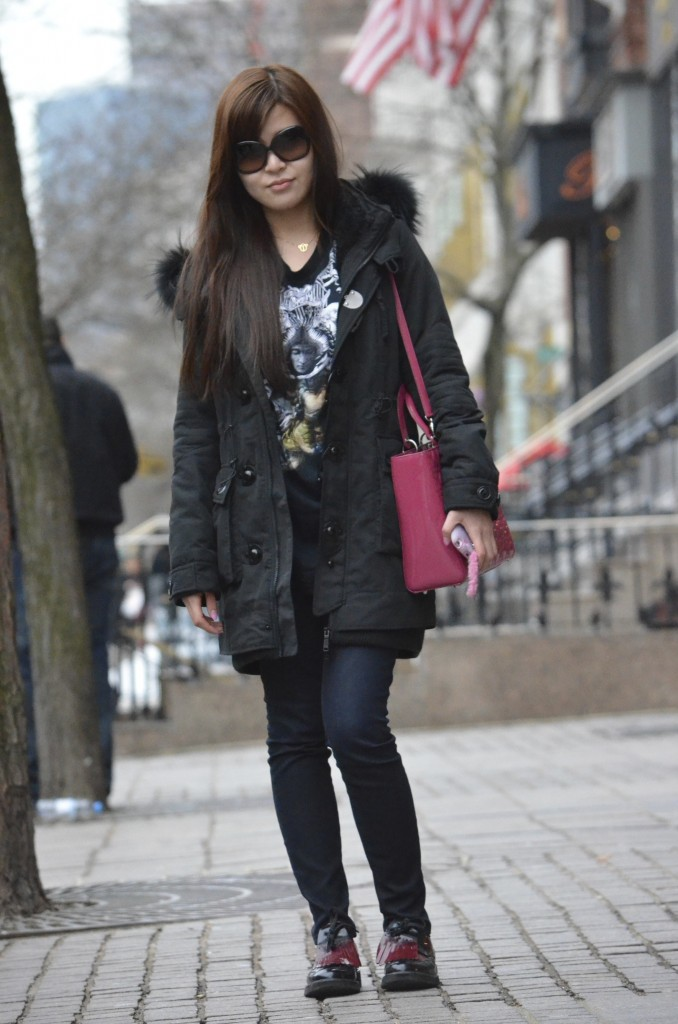 Mindy Li, 19 - Communications Design studentChineseHow would you describe your style?The cool girl.What does fashion mean to you?People judge first impressions by what others wear, so formulate your unique style and dress to what's important to you. I don't follow particular brands, rather if I like this shirt, I'll buy it.What are you currently wearing?Grungy shirtPrada tassel loafersCartier braceletsDior patent top handle bagWhat inspired your look today?[It's] easy to walk around in, though I always wear black and occasionally colors.What is one fashion accessory you can't live without?Bracelets!