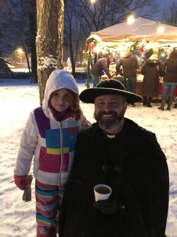 kid with Rick at christmas market 2.jpg
