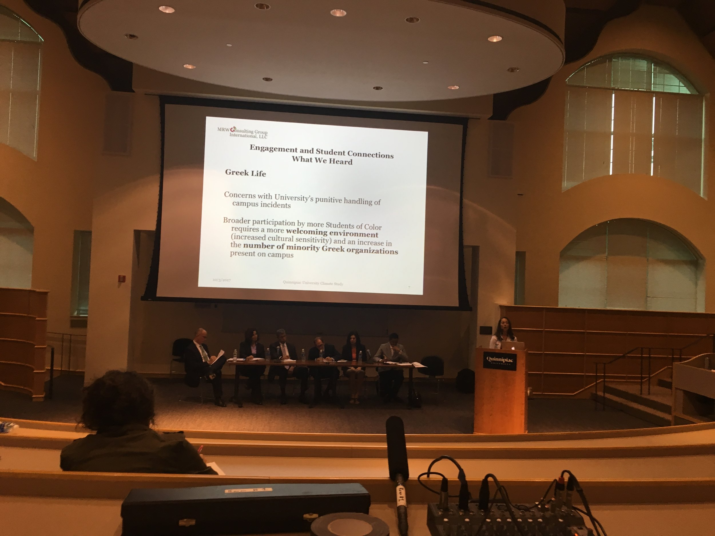 A representative from MRW Consulting Group discusses findings from the campus climate study during a university town hall.