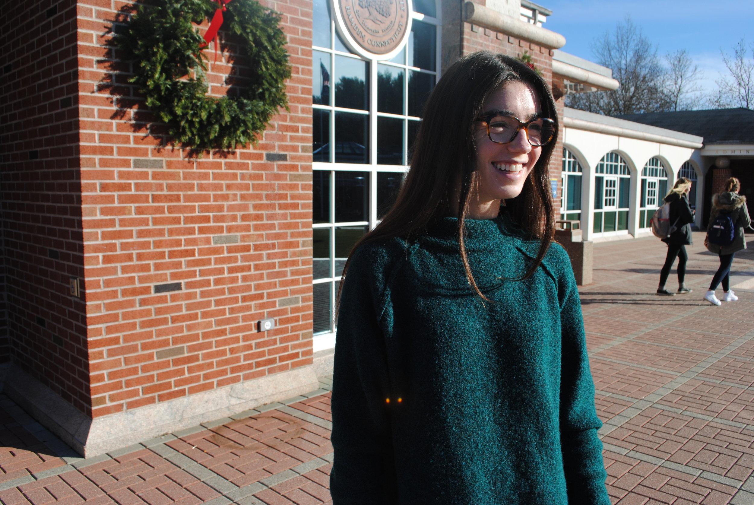 Senior health science major Danielle Rattotti outside of the library.
